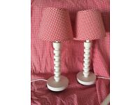 Red gingham curtains with white rail plus 2 bed side table lamps to match