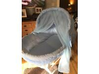 Moses basket kitted out in blue