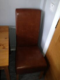 Table and brown leather chairs. Few scratches genes price . Still good condition
