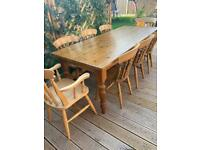 Solid pine 7ft dining table with drawer plus 8 chairs. Possible delivery