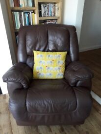 Leather recliner chair, brown, great condition. Also rocks and swivels.
