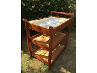 Solid wood changing table. Mat included. In very good condition. From a smoking and pet-free home
