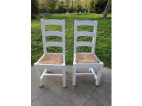 Large rustic oak dining chairs with rush seats x 2. Antique white.