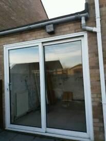 Sliding white patio doors