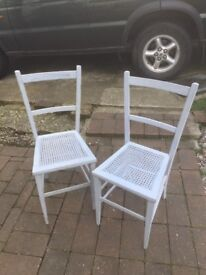 2 small wobbly chairs for sale, wicker seats painted sweet but scruffy.