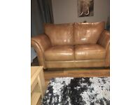 Selling 2x 2seater brown leather sofa 1x footstool.