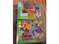 Two boxes of Early Learning puzzles