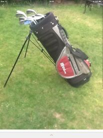 Wilson golf bag and various clubs