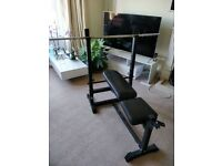 Marcy weight bench, 1x dumbell, 3x barbells and 35 cast iron weights totalling 108kg.