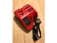 Brand new milwaukee rapid charge battery charger, 18v and 12v