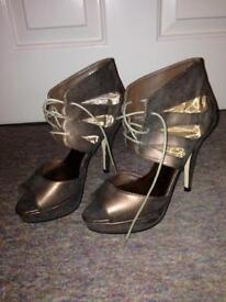 Rose gold heels. Size 6. Never worn. Labels still on.