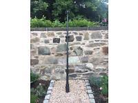Original cast iron washing pole painted black