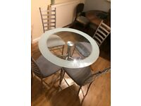 Dining table glass round with 4 chairs for sale
