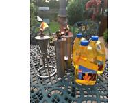 Citronella oil burners x 3 metal burners with 3 x 2L unopened torch oil . Used - all still working