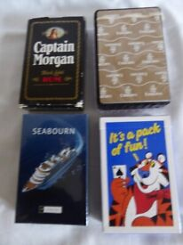 Four promotional packs of Playing Cards - Flying, Sailing, Drinking and Breakfast related