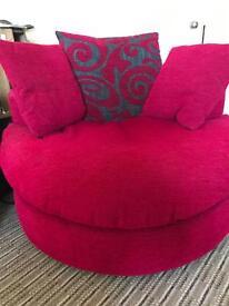 Pink swivel sofa chair