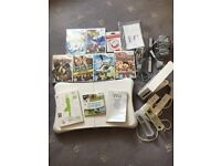 Like new Nintendo Wii console bundle plus games controllers wii fit board etc