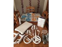 Wii console, Wii remote, Wii board, range of accessories and games