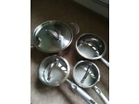 Set of 4 Stainless Steel Pans - excellent condition, all with lids. Induction hob compatible.