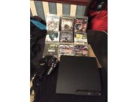 PlayStation 3 (PS3) Slim 250GB fully working comes with 9 games an controller