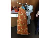 Ironing board with adjustable covers