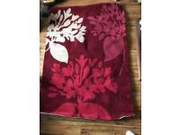 Red floral wool rug