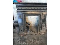 Cast iron fireplace and top which has been painted black but is in good condition