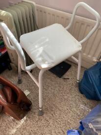 Adjustable height bathroom/shower seat