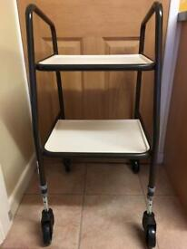Adjustable trolley mobility aid