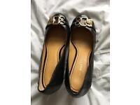 Ladies black leather court shoes