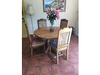 Solid Oak ornate table and 4 chairs