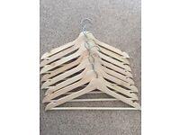 8 new wooden hangers