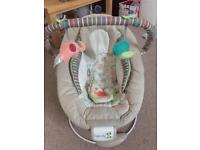 Baby bouncer with vibration and nursery rhymes