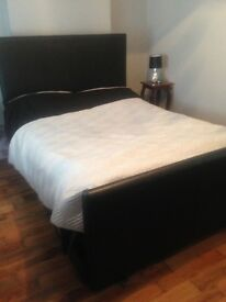 Black double leather bed with underneath storage