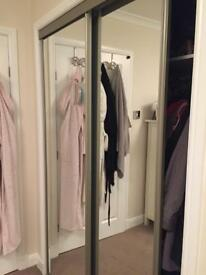 Wardrobe mirrored sliding doors