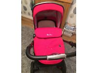 Silver cross pioneer pram with red colour pack.