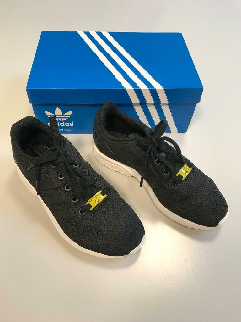 Black Adidas female trainers