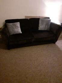 Large 3 seater black fabric sofa and matching love seat.