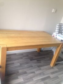 Solid oak dining table. (Without chairs)