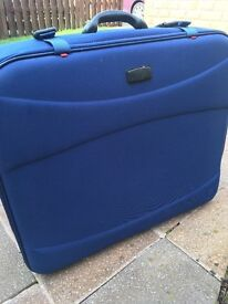 Suitcases in blue (Antler). One stores inside the other.