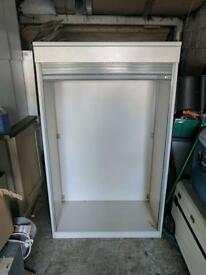 Metal frame cupboard with roller shutter