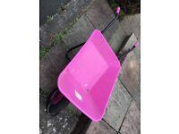 Garden Pink Wheelbarrow has a Flat Tyre