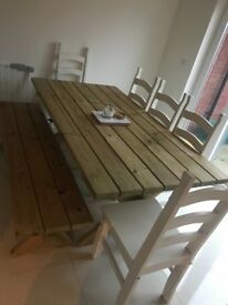 Solid wooden dining / garden table
