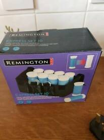Remmington heated rollers boxed with instructions and case