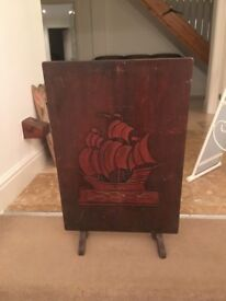 Handsome fire guard. Dark wood with Blue Peter carving
