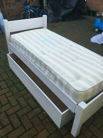 Small single white painted bed with large drawer and mattress