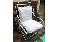 Folding heavy white garden chair