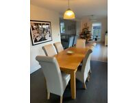 Extendable oak dining table and six chairs