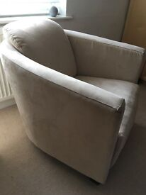 Two beige suede tub chairs wooden framed
