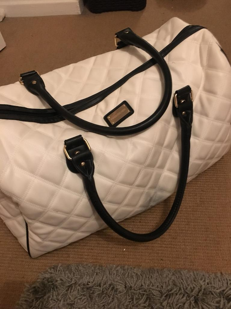 White carry on bag
